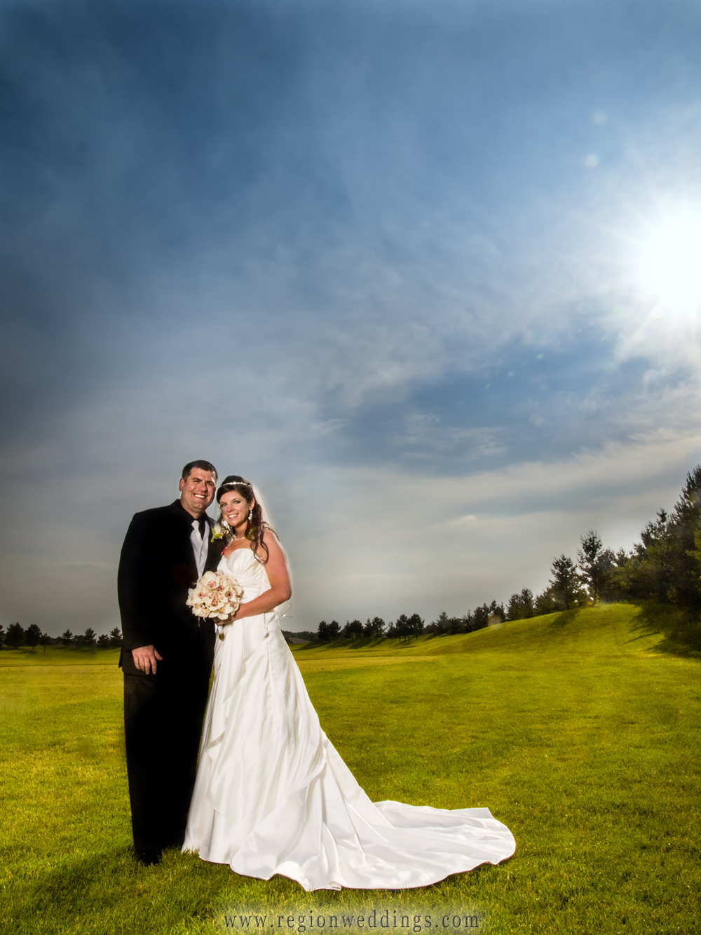 Bride and groom formal wedding photo on the golf course at White Hawk Country Club.