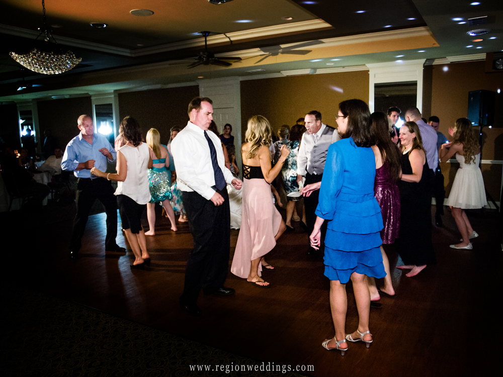 The dance floor at White Hawk Country club during a summer wedding reception.