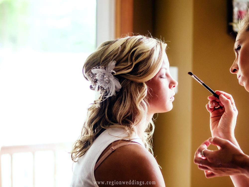 The bride gets make up applied at her parent's home in Northwest Indiana.