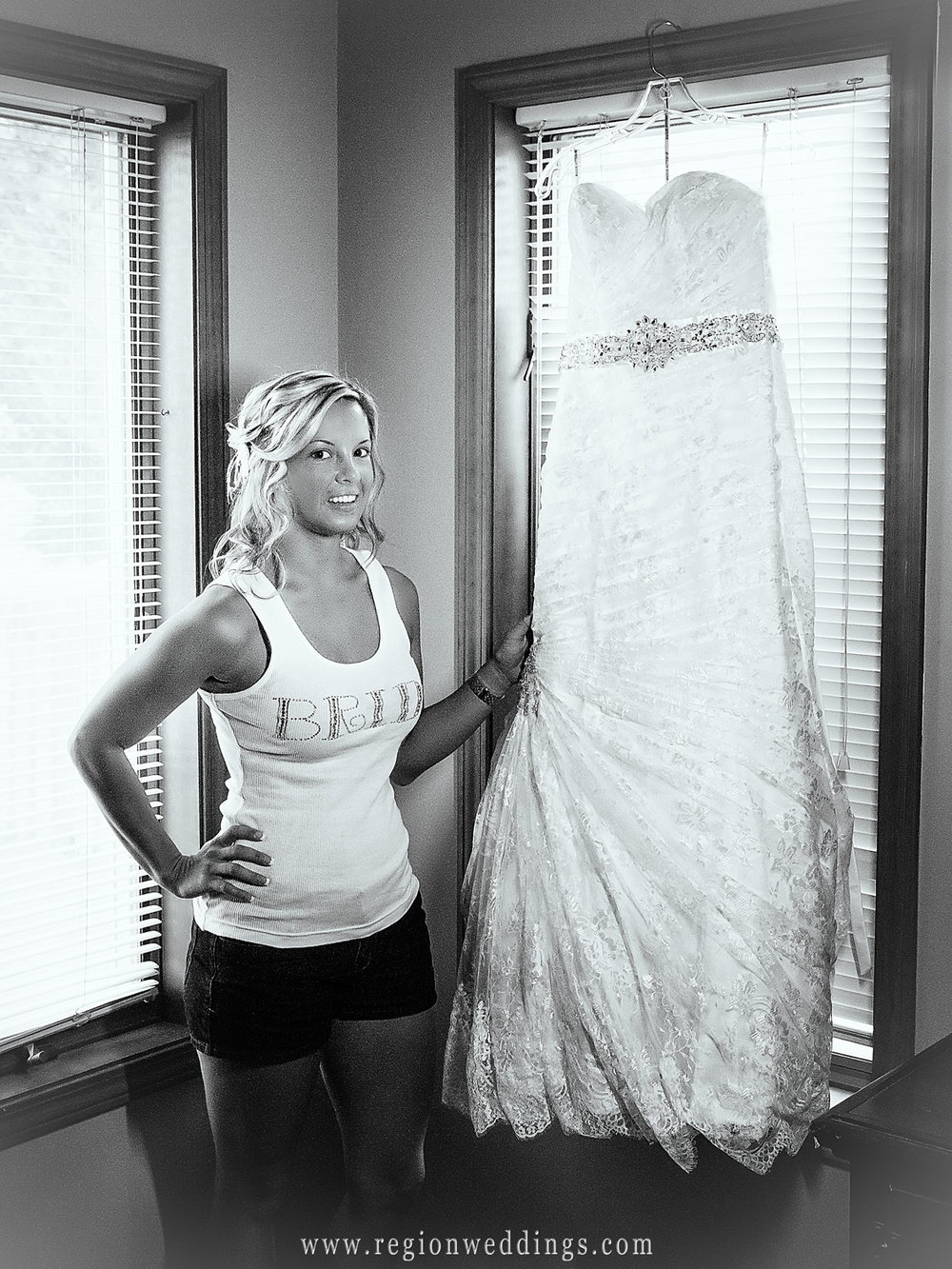 The bride shows off her dress on her wedding day in Schererville, Indiana.