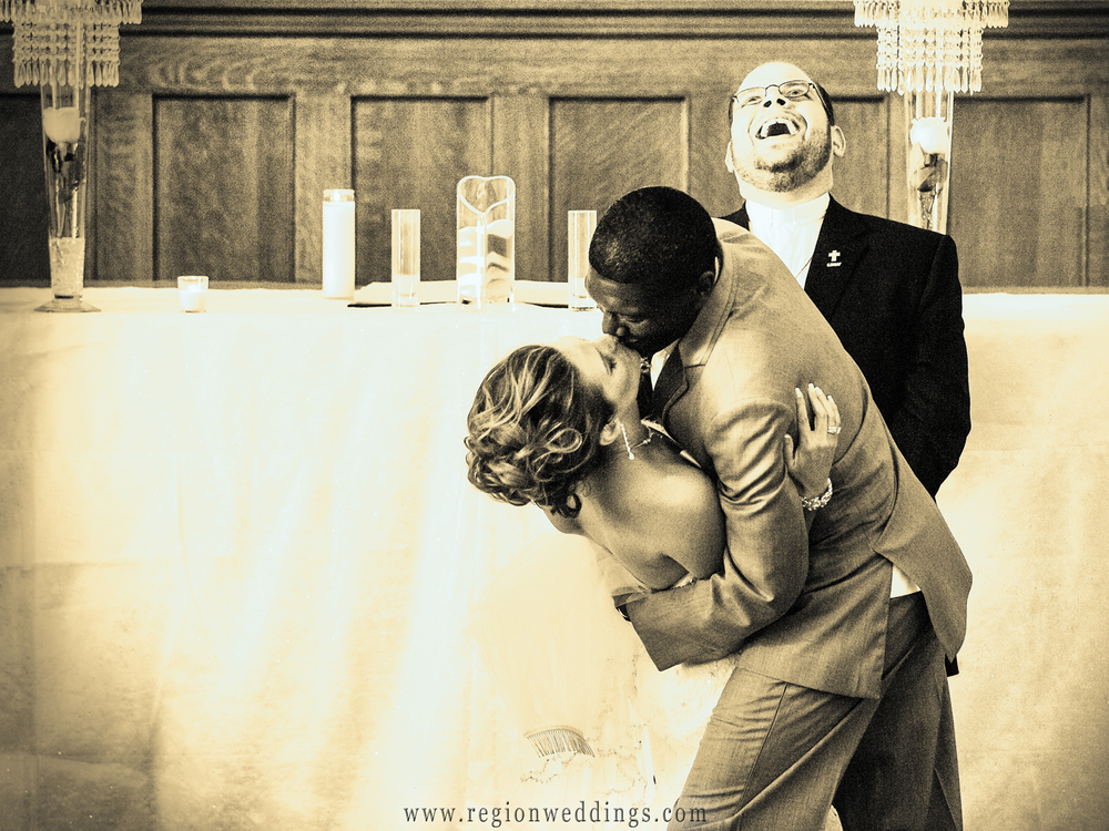 The groom dips his bride during the first kiss at their wedding ceremony at the Crown Point courthouse.