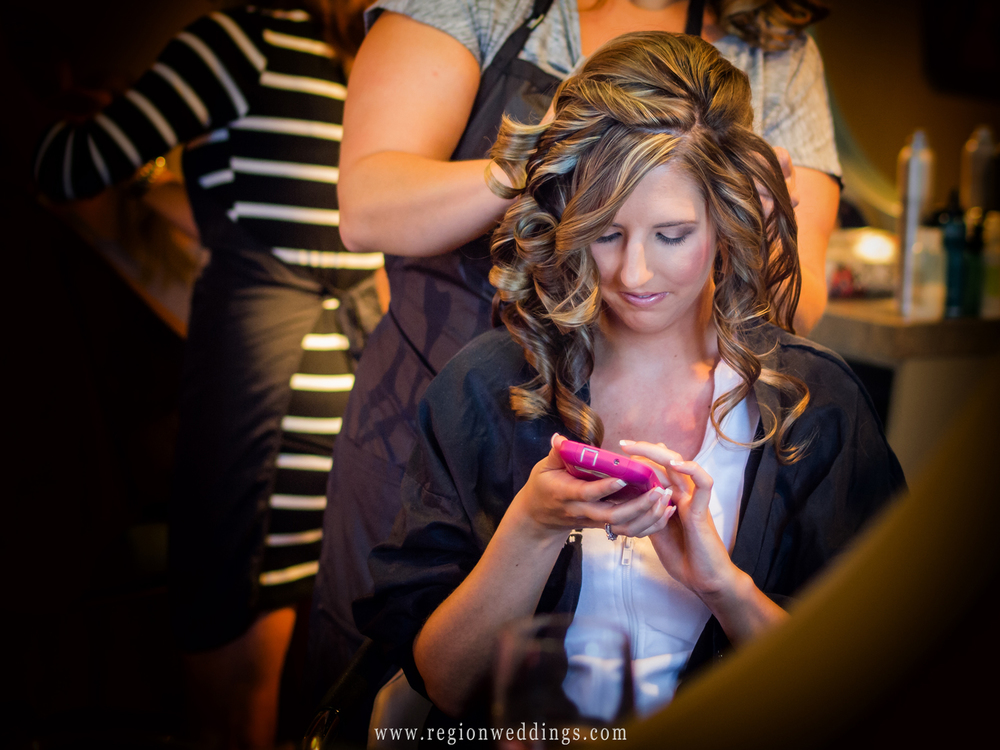 The bride sends text messages of love to her soon to be husband.