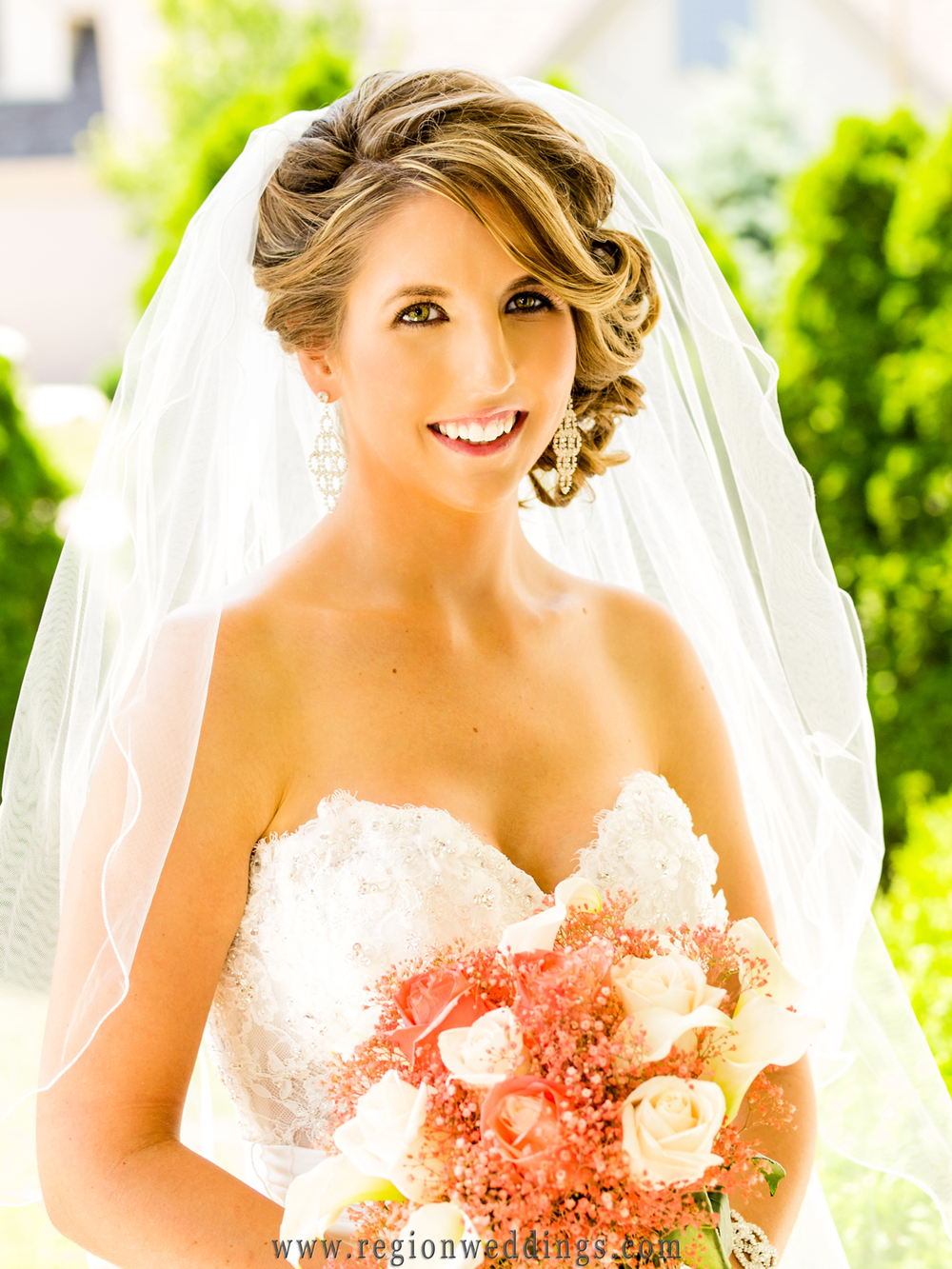 A bride basks in sunshine for her wedding day portrait at her Cedar Lake home.