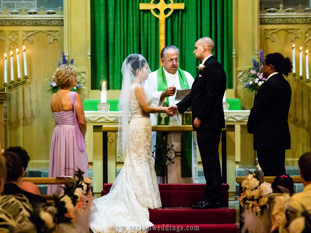A Korean bride and an American groom exchange vows at Trinity Lutheran Church.