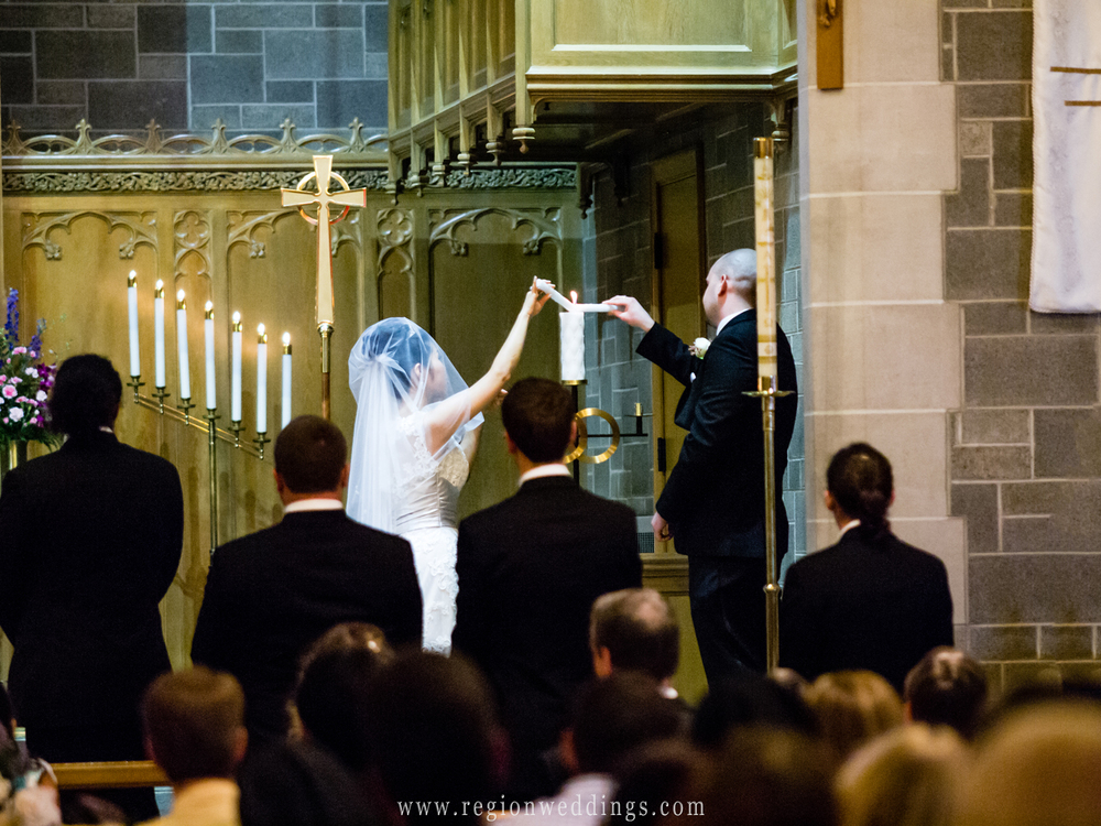 The bride and groom light the unity candles at Trinity Lutheran Church in Northwest Indiana.