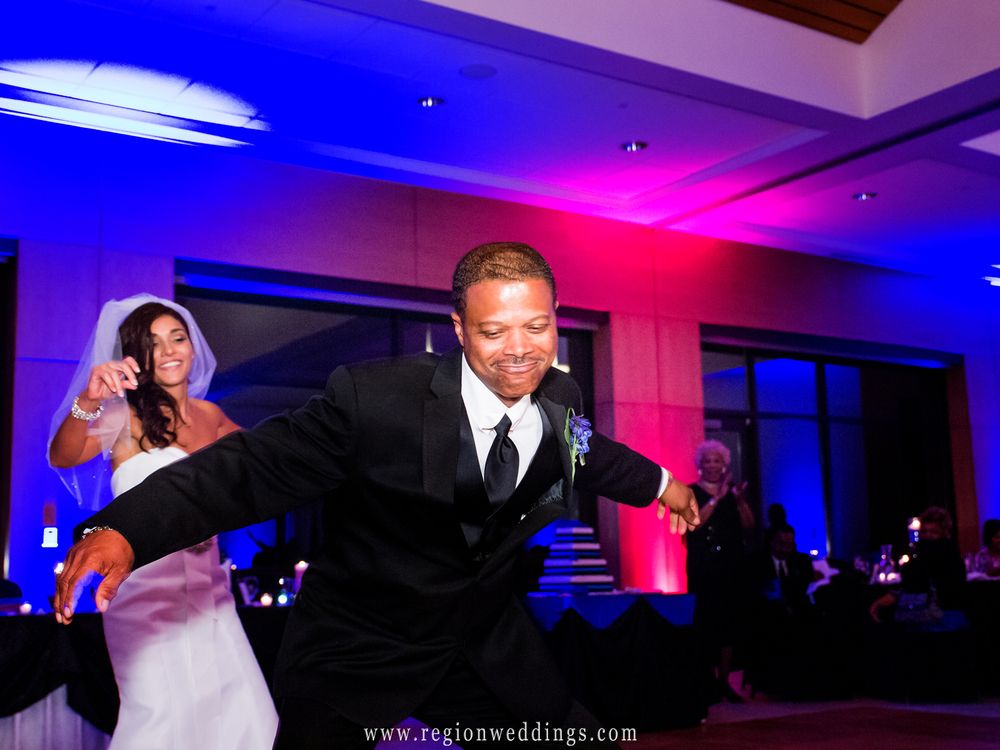 Father and daughter fast dance at a reception at Centennial Park.