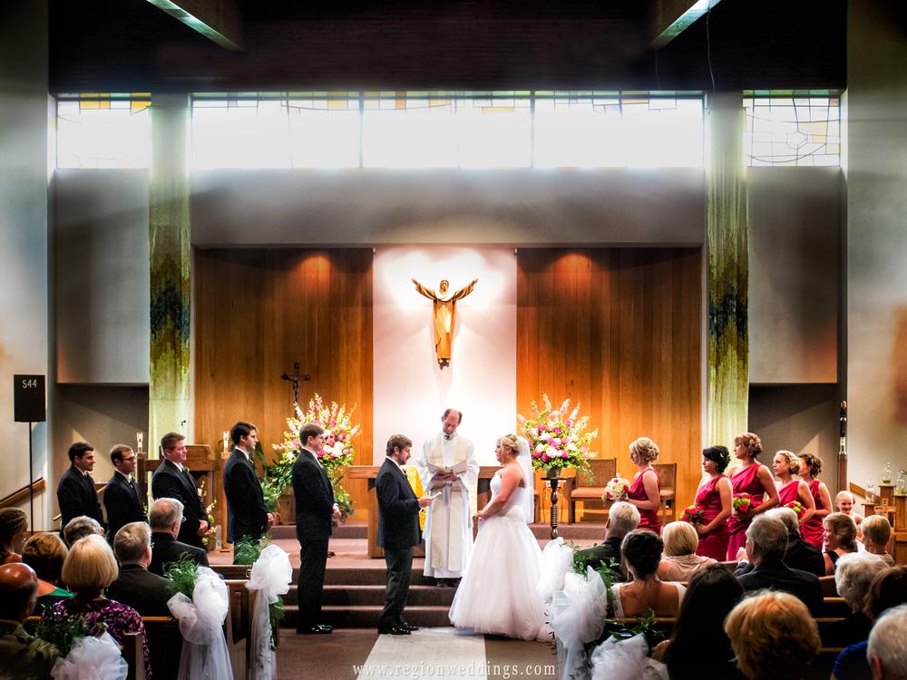 Light rays stream through the windows at St. Elizabeth Ann Seton Church during a wedding ceremony.