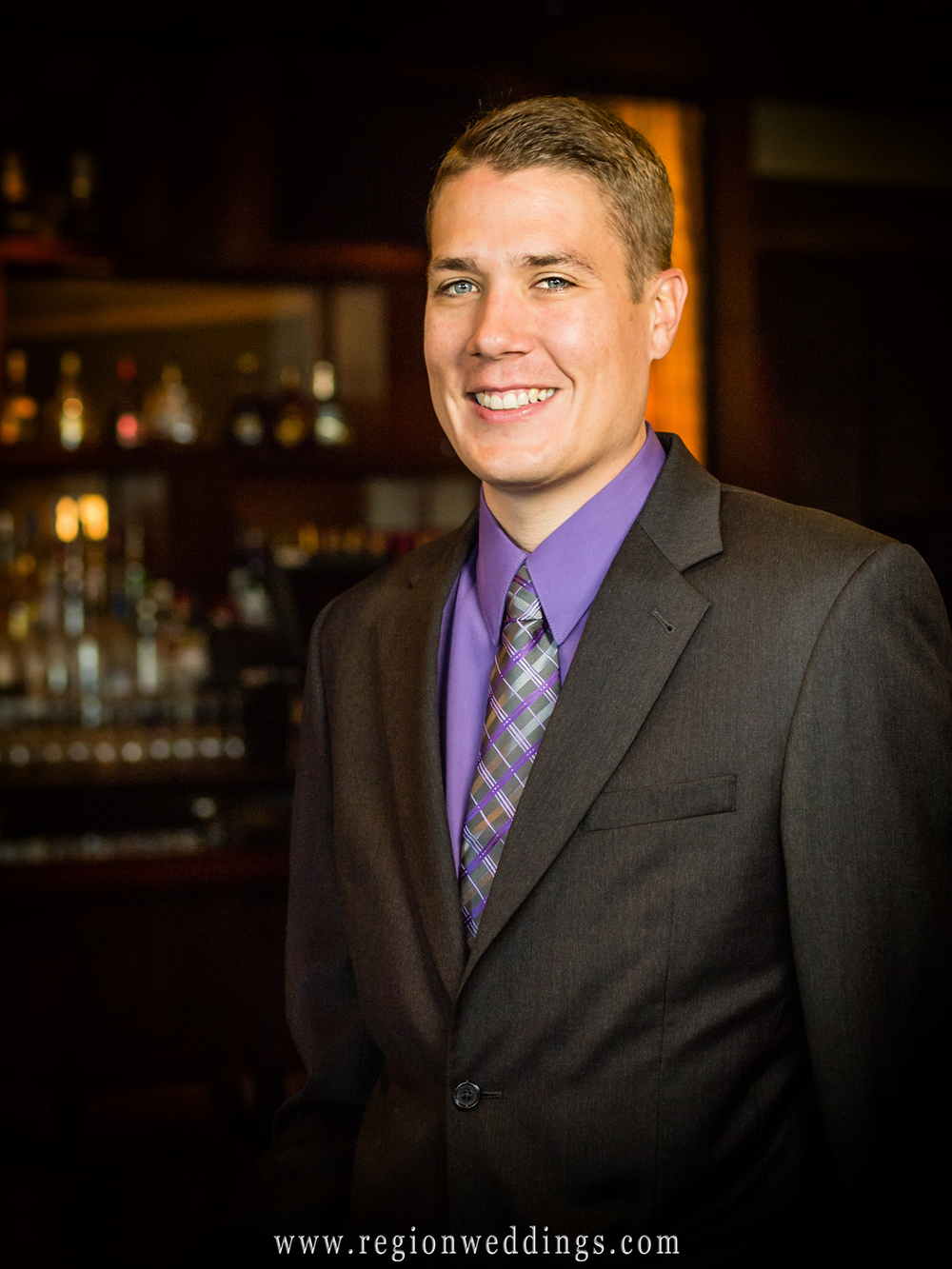 The groom poses for his wedding portrait in front of the hotel bar at Blue Chip Casino in Michigan City.