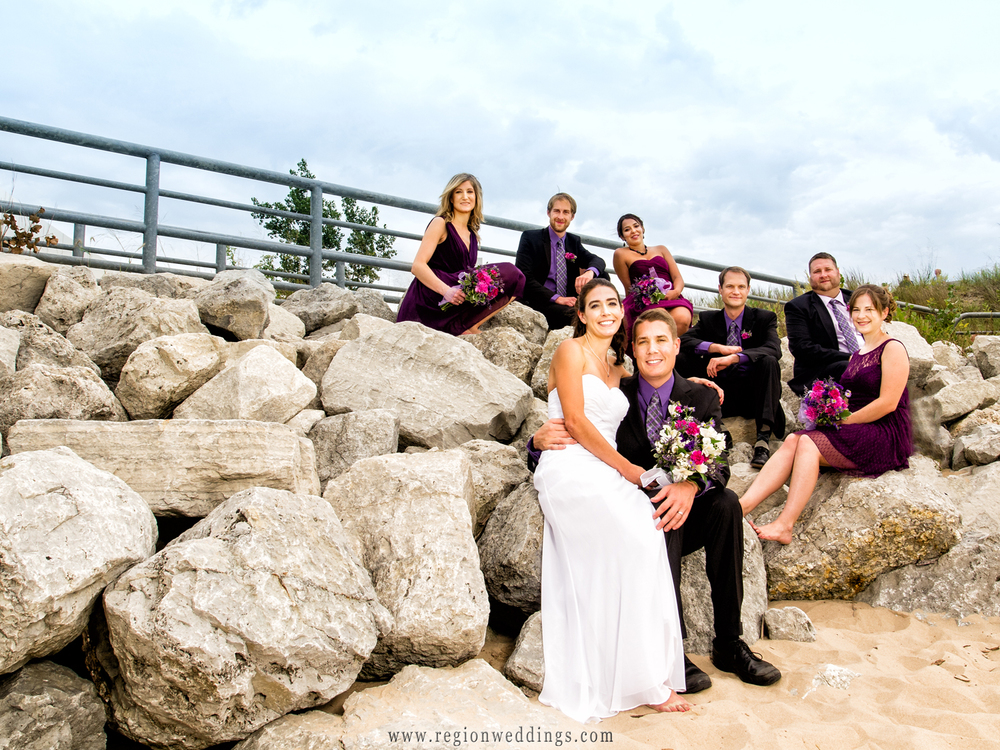 The wedding party climbs atop the rock formation at the Portage River Walk for a group photo.