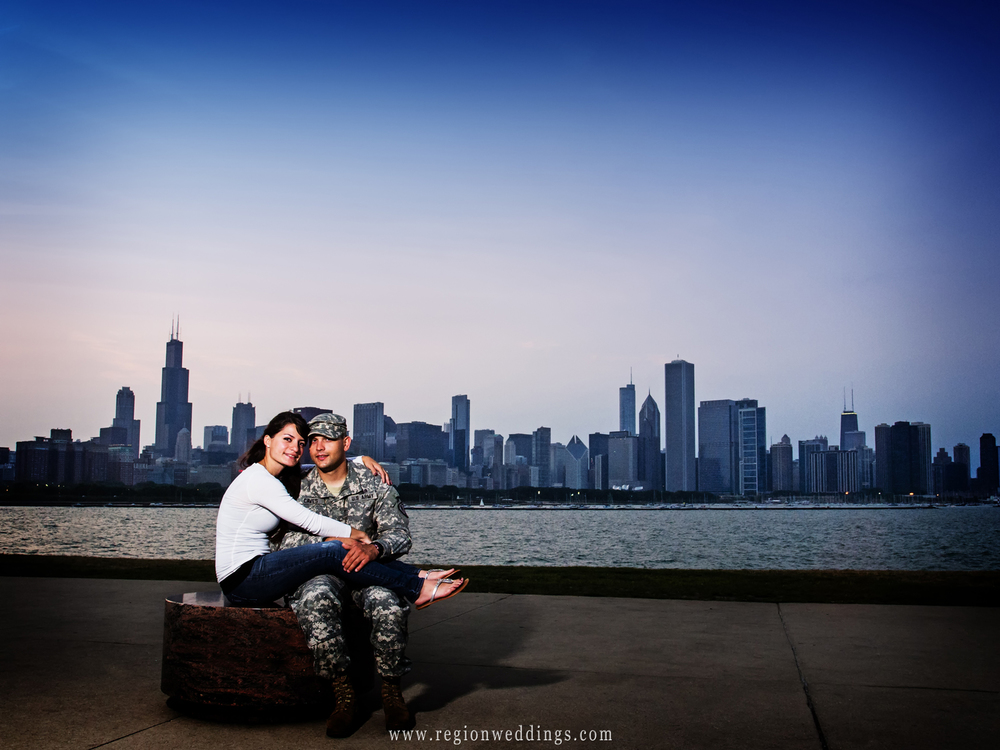 The Chicago skyline fills the background for an engagement photo from the Adler Planetarium terrace.