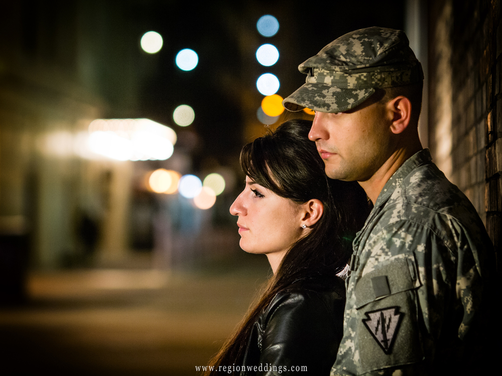 A soldier and his girl take in Chicago city life at night for their engagement photos.