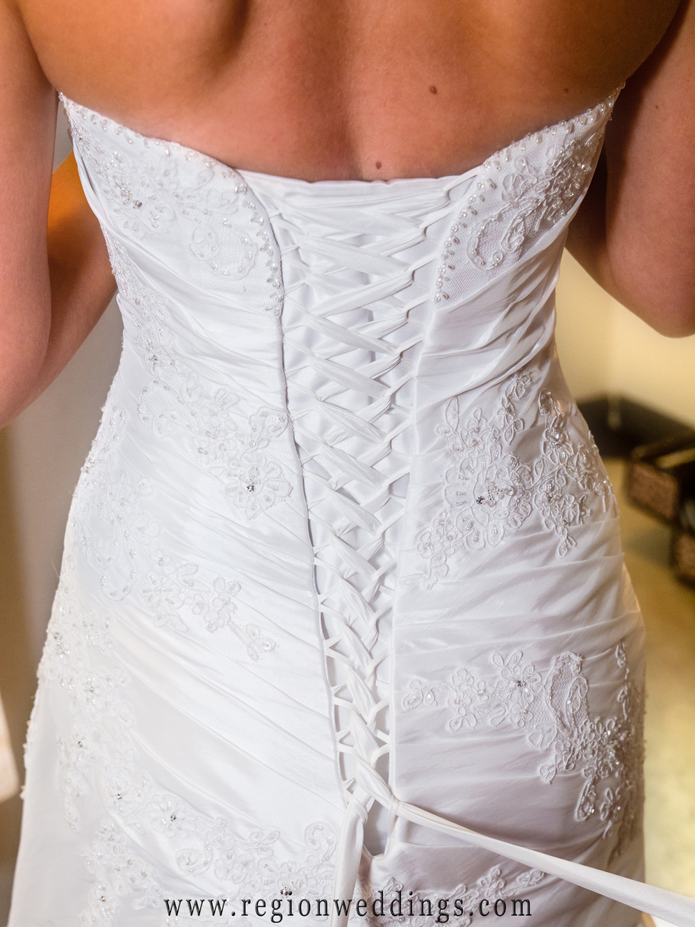 The lacings of a stunning white wedding dress.
