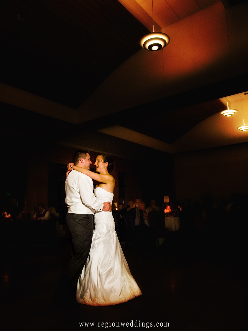 Centennial Park clubhouse is aglow in Fall colors during the first dance at a wedding reception during the Autumn months.