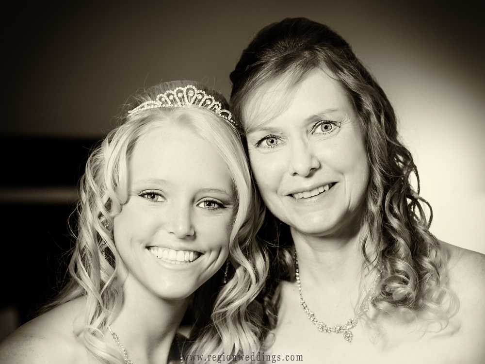 The mother of the bride poses with her daughter for a portrait just before the wedding ceremony.