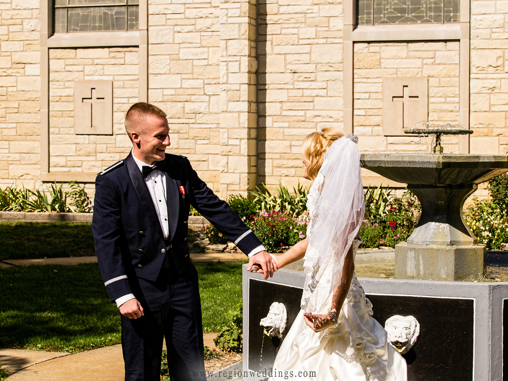 An air force soldier turns to greet his bride for their first look at St. Mary's church just before their military wedding.
