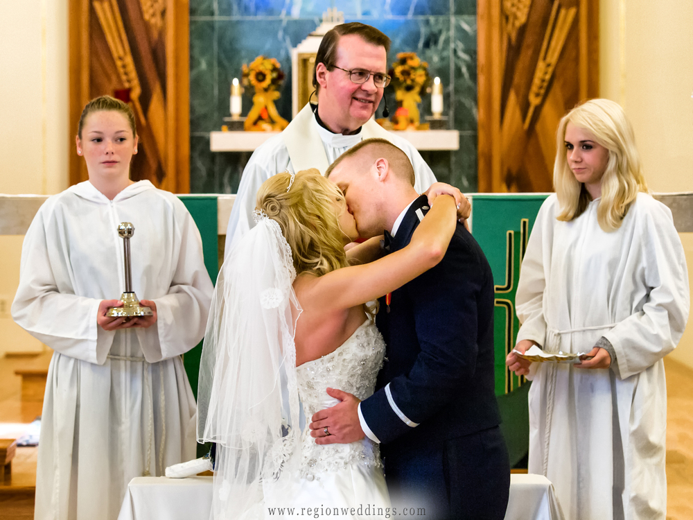 The first kiss at a Catholic wedding ceremony at St. Mary's Church.