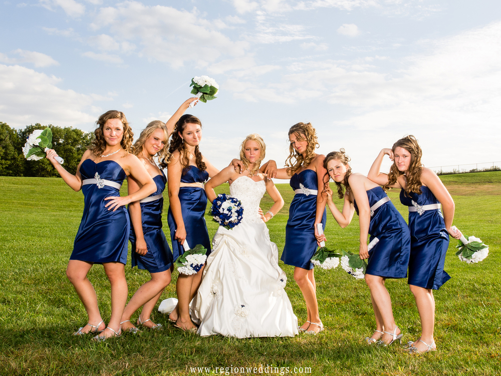 In this fun wedding photo, the girls emulate the Bridesmaids movie poster by looking disheveled and mugging for the camera.