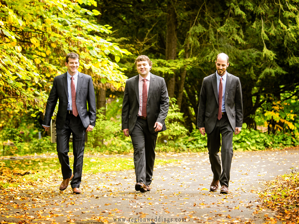 The groomsmen take a stroll through the woods of Fernwood Botanical Garden.