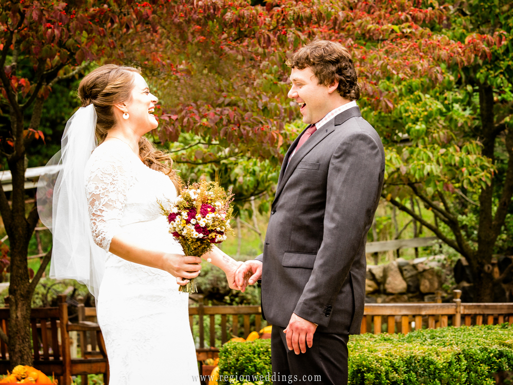 An overjoyed groom reacts during the first look at Fernwood Botanical Garden.