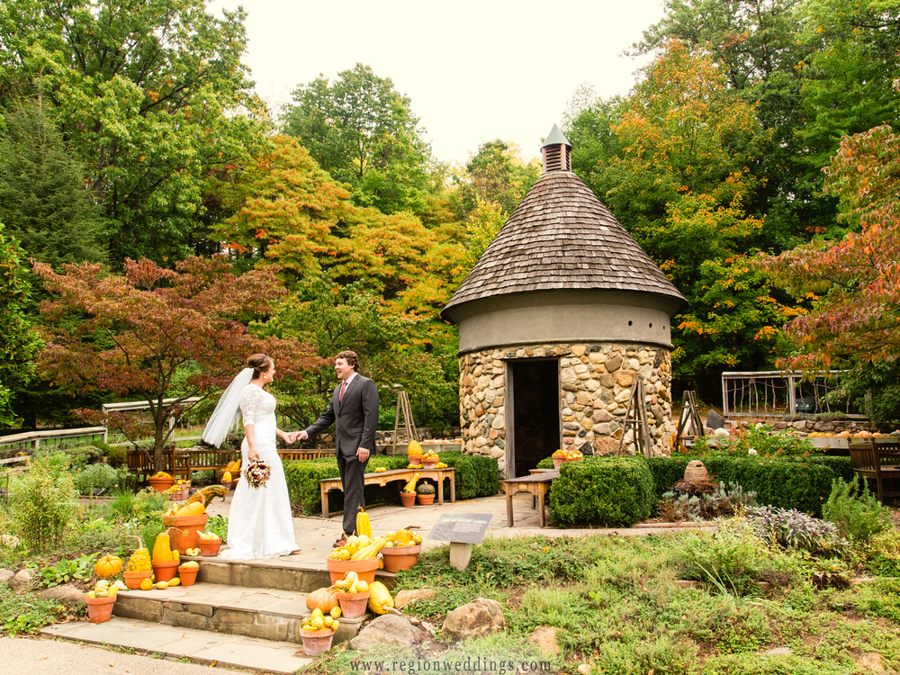 The bride and groom first look at the gorgeous pumpkin garden during their Fall wedding in Niles, Michigan.