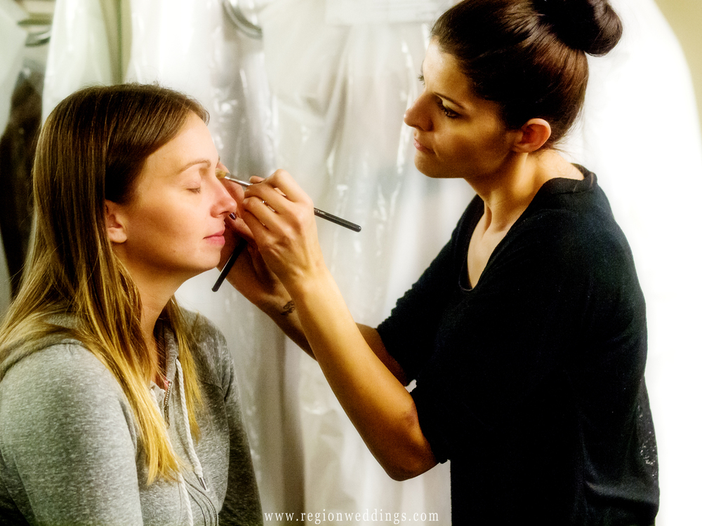 A make up artist attends to the bride inside of the bridal suite at the Patrician.
