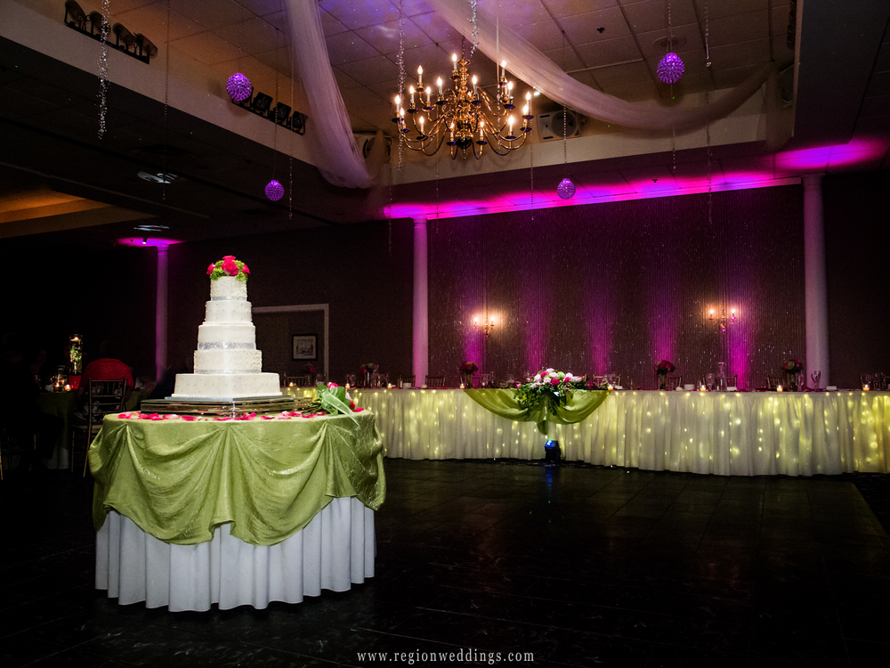 The wedding cake sits alone on the dance floor of the elaborately decorated Aberdeen Manor ballroom.
