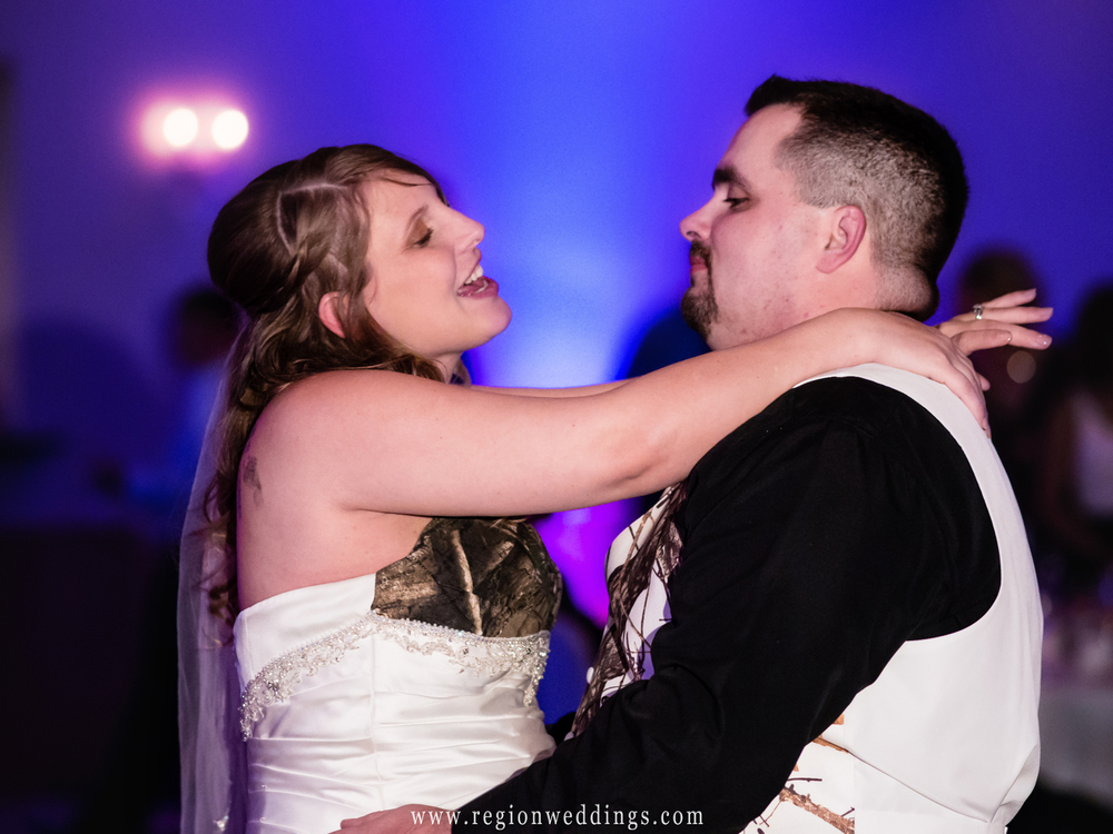Bride sings to her new husband during their first dance.