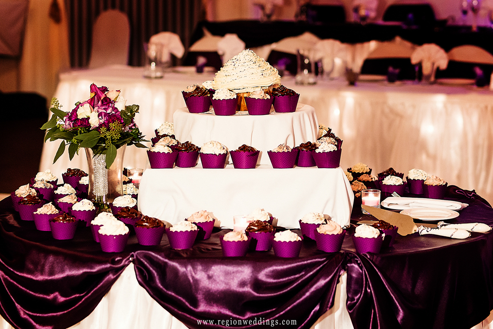 A mountain of cup cakes are served at a Fall wedding reception at Dream Palace.