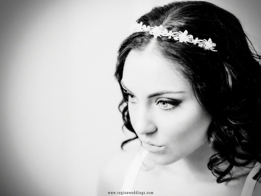 A brides sits in her tiara on her November wedding day.