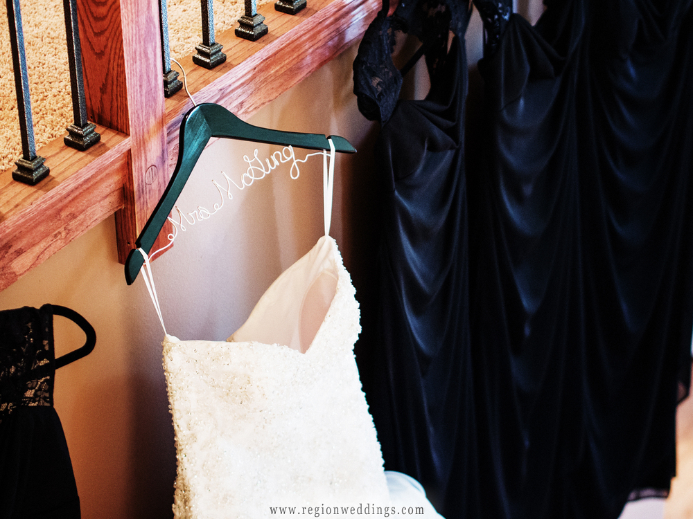Wedding dress hanger with the bride's married name.