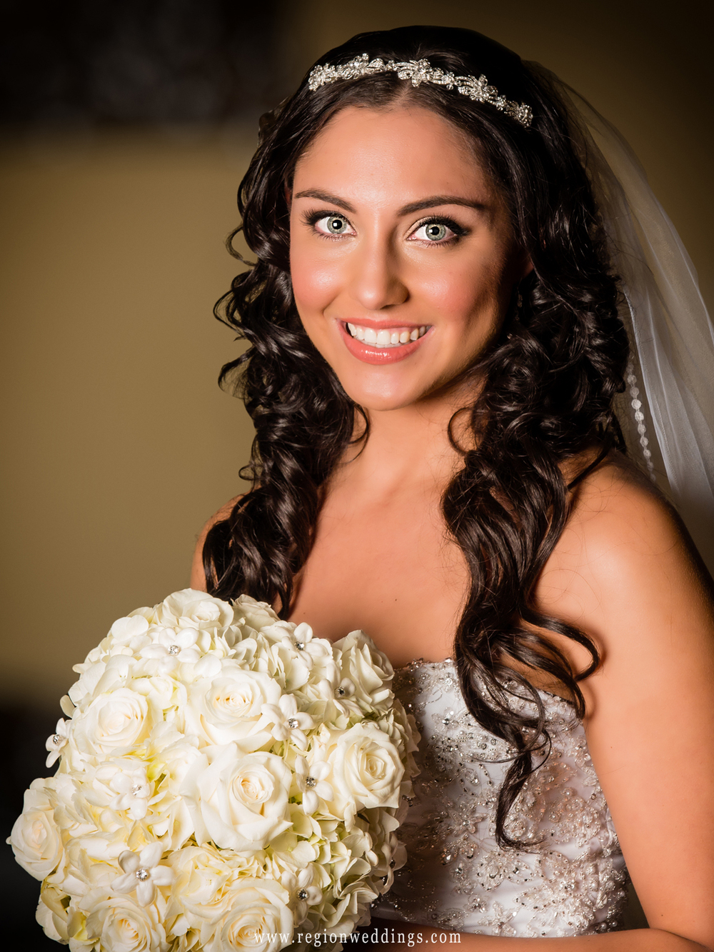 A bridal portrait of a lovely brunette bride.