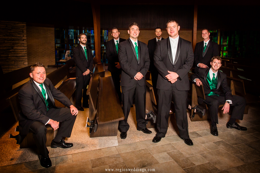 The groomsmen pose in the pews of Our Lady of Grace Church in Highland, Indiana.