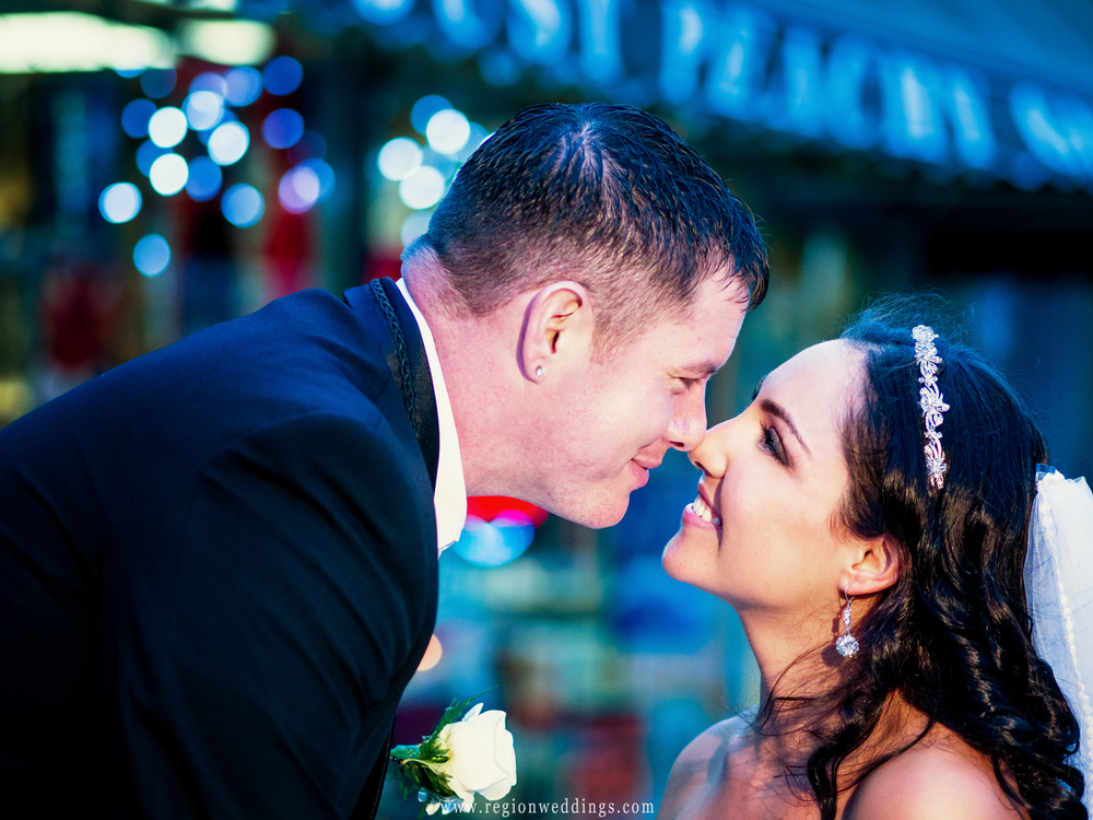 The bride and groom go nose to nose in this cute wedding photo.