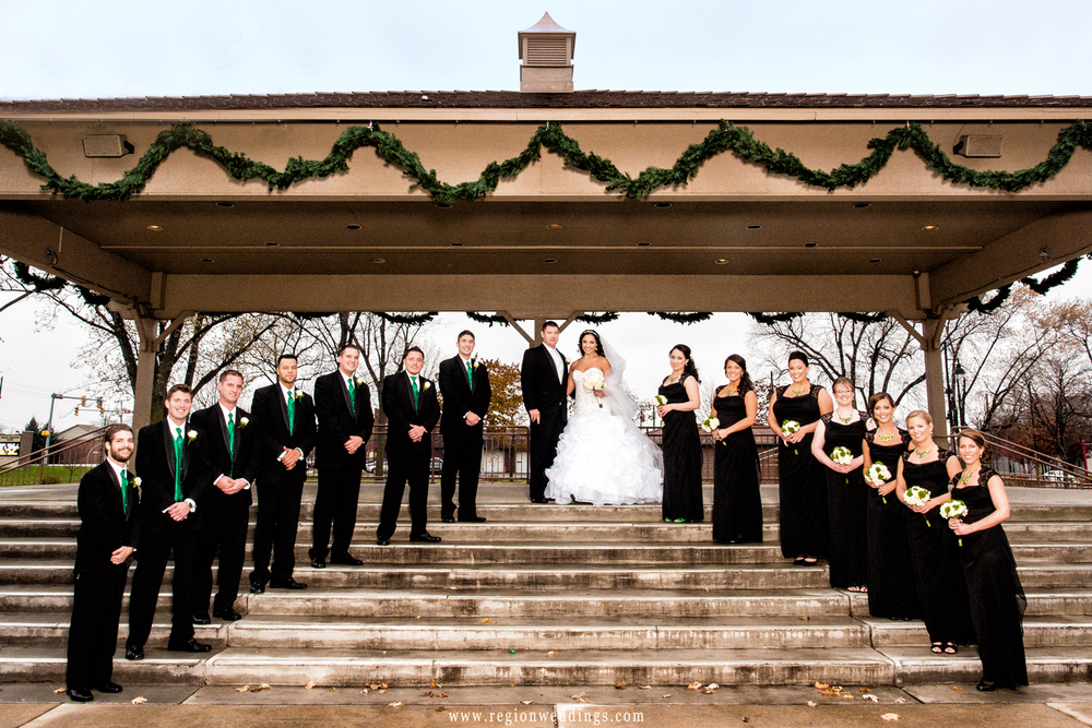 Wedding party poses on the steps to the band shell at Highland Park.