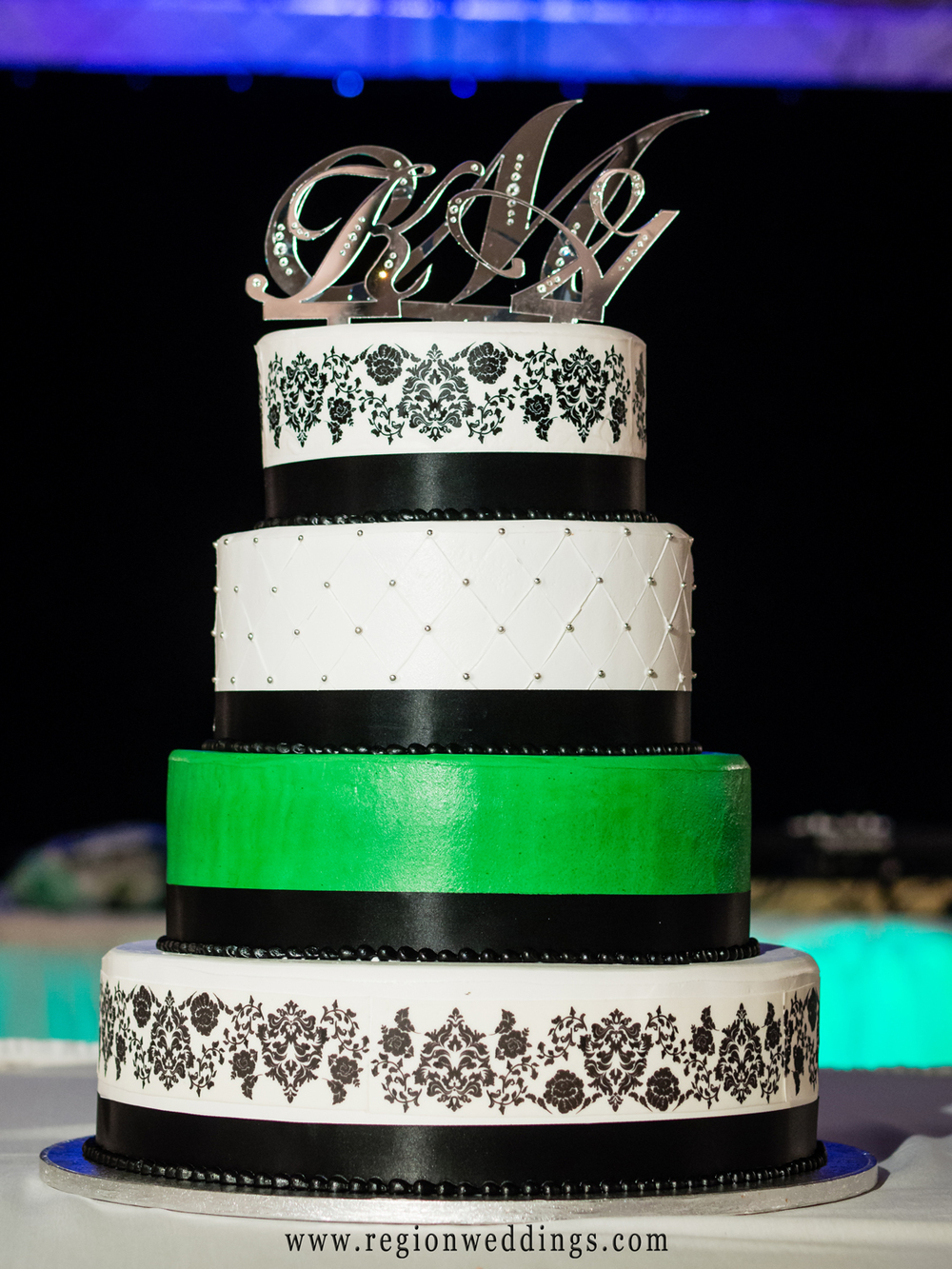 Green striped wedding cake.