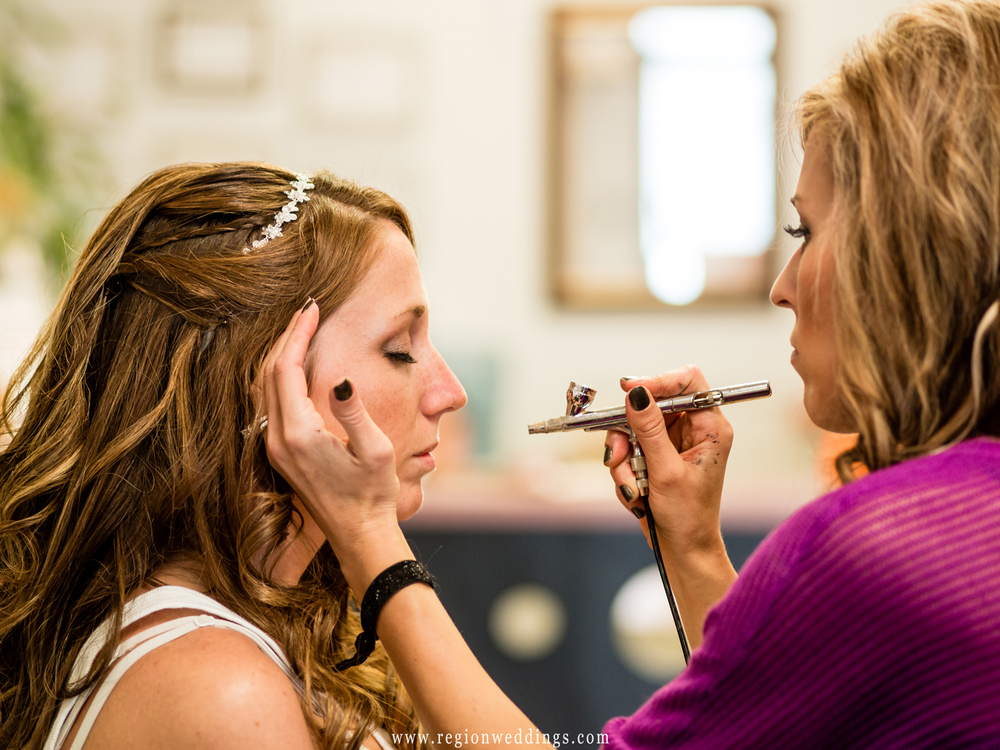 A make up artist from Sta-glam applies make up to the bride.