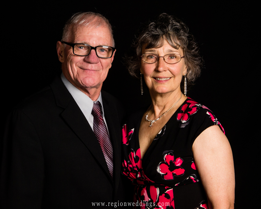 Grandparents pose for a portrait together at their grand daughter's wedding reception at Casa Maria in Dyer, Indiana.