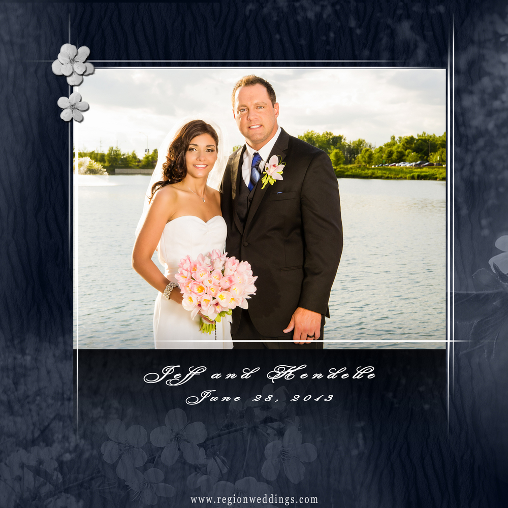 Front cover design of a wedding album with blue background and white flowers.