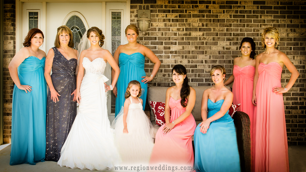 The bride and her bridesmaids pose for wedding photo on the porch of her home in Cedar Lake.