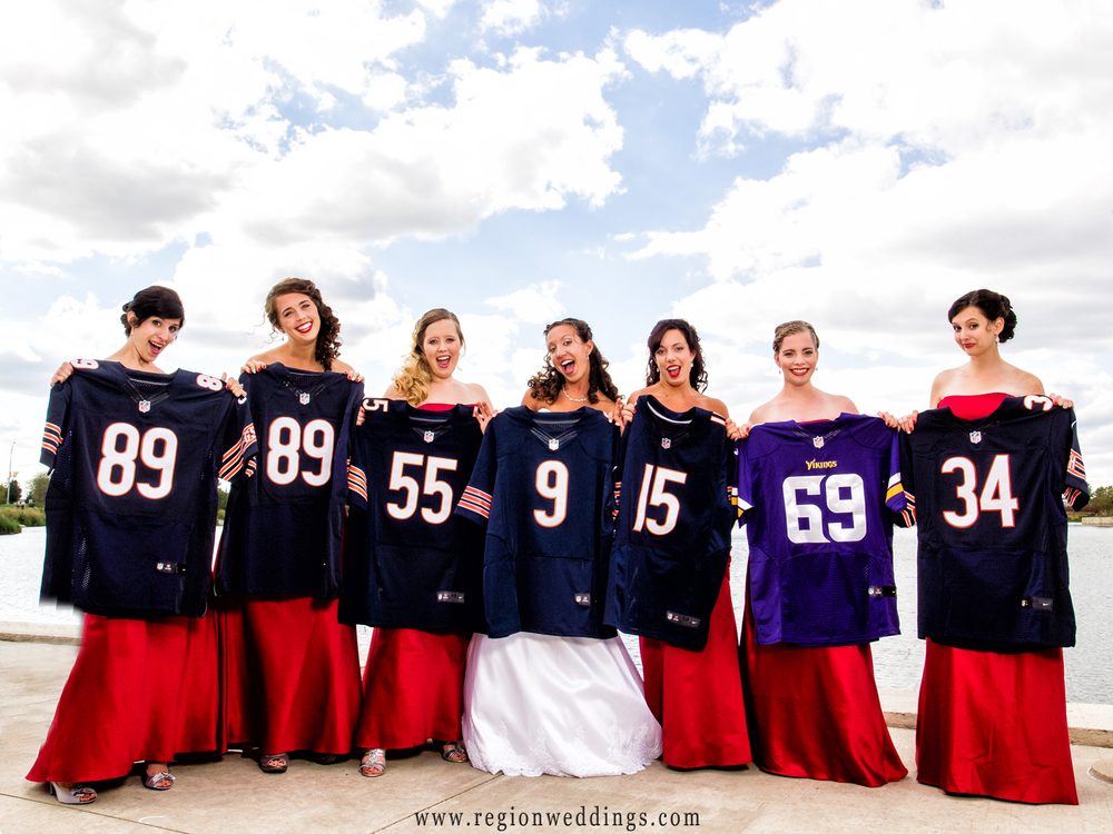 Bridesmaids hold up Chicago Bears football jerseys in front of their dresses for a Fall wedding photo.