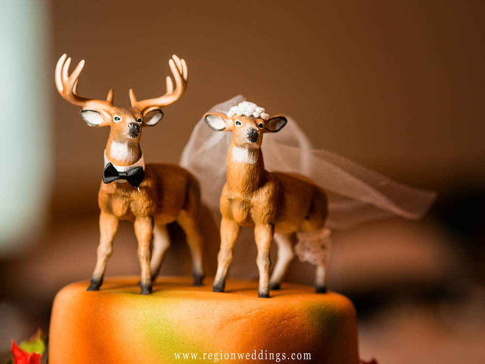 Wedding cake toppers of the deer dressed as a bride and groom.