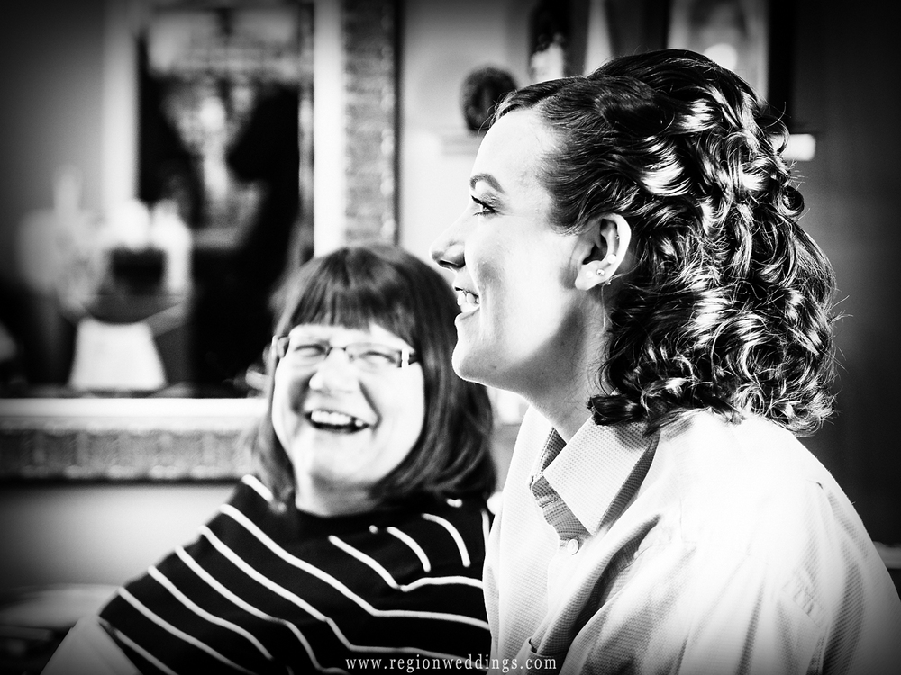 Mother and daughter share a laugh on wedding day.