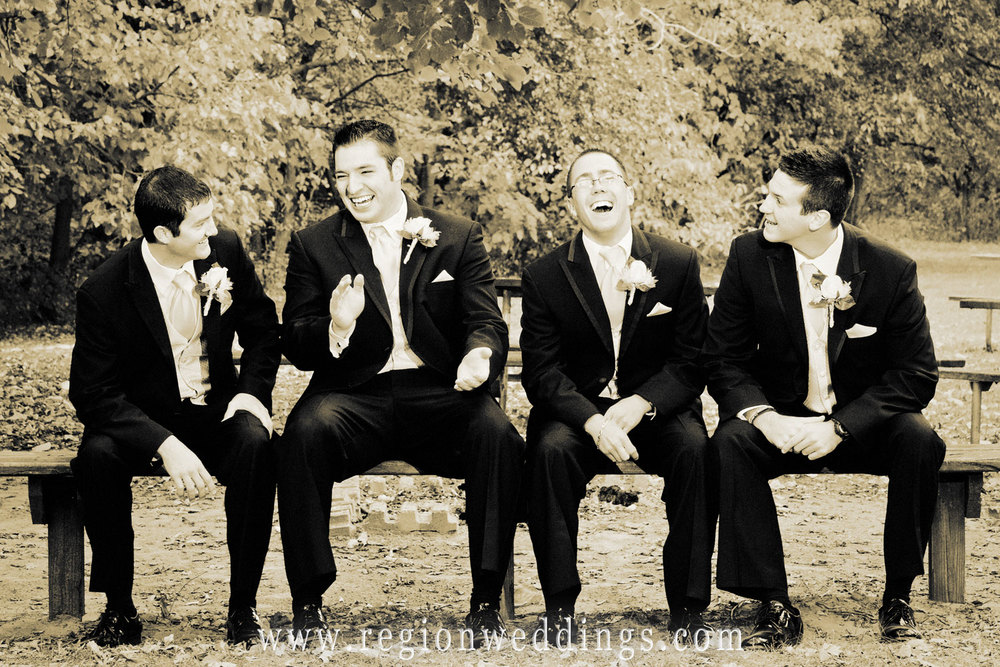 Groomsmen share a laugh at Deep River County Park.