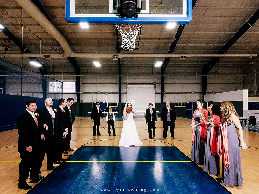 The bride shoots free throws at Lincoln Center gym on her wedding day.