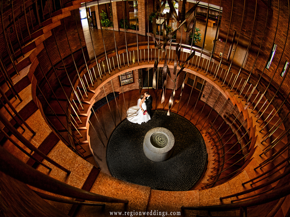 Bride and groom kiss at the bottom of the staircase at the Chapel of the Resurrection