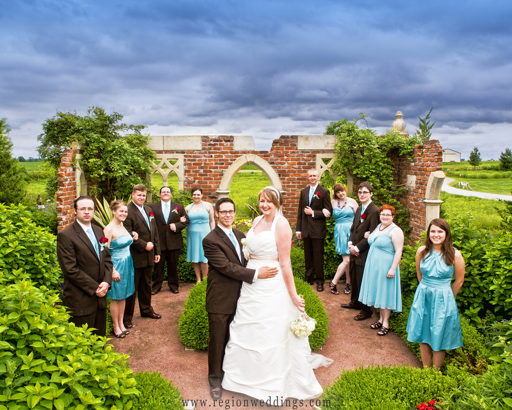 Wedding Party group photo in front of The Ruins at Gardens on the Prairie in Lowell, Indiana.