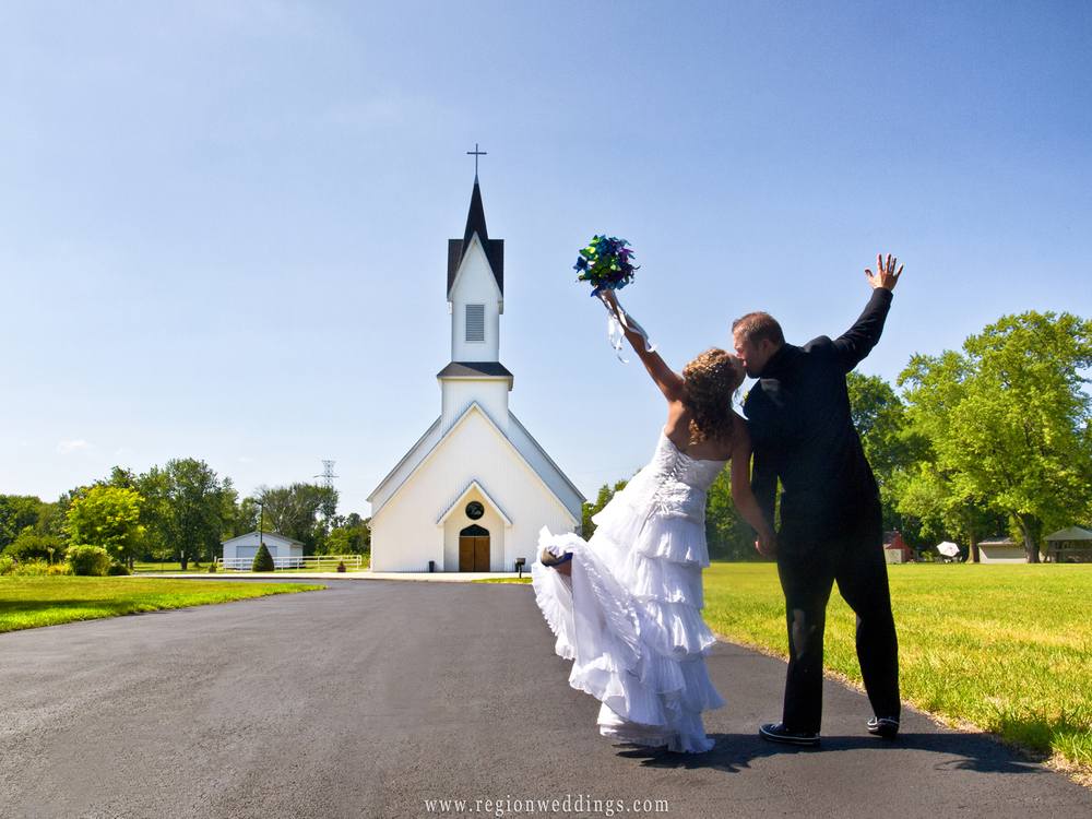 The bride and groom dance their way toward Grace Lutheran Church in Hobart, Indiana.