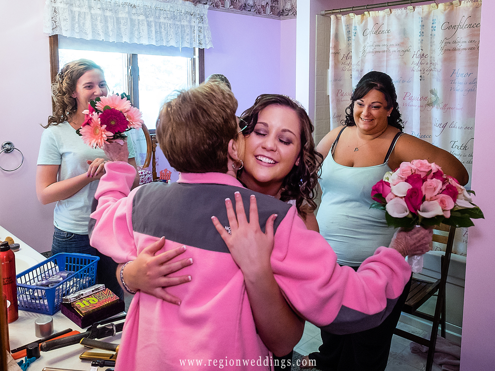 Pink wedding flowers get delivered at the home of the bride.