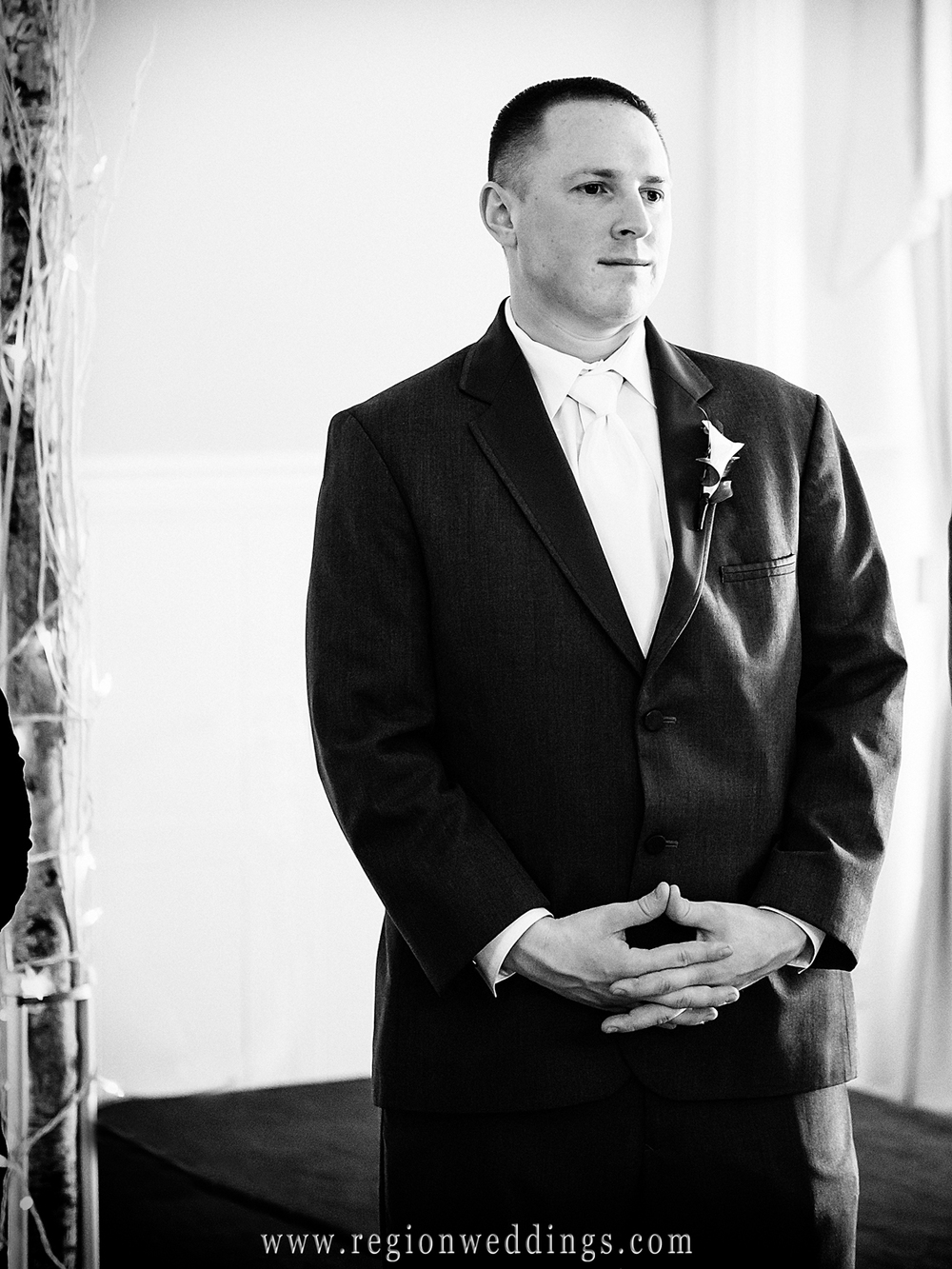 The groom reacts as he sees his bride for the first time.