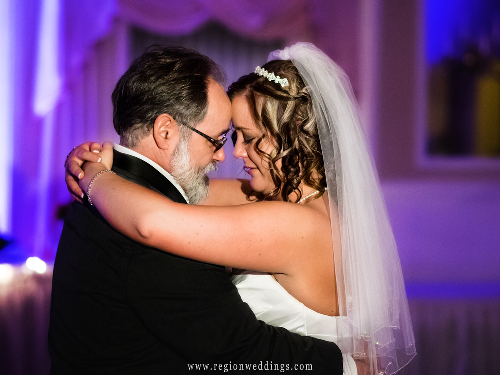 The bride tears up during the first dance with her Father.